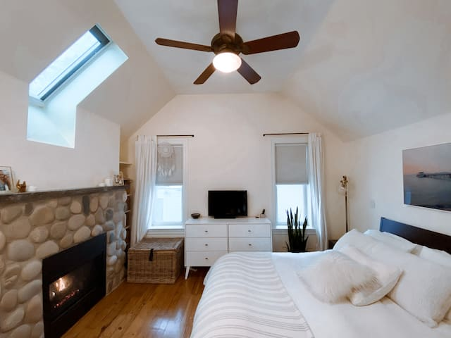 Large master bedroom with Queen Bed and a beautiful remote powered skylight is great to wake up to. Gas fireplace to keep you warm during winter months