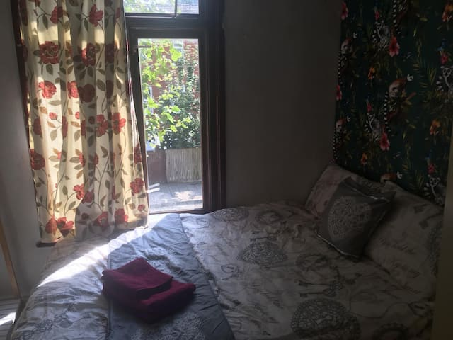 Room with double bed in trendy Hackney