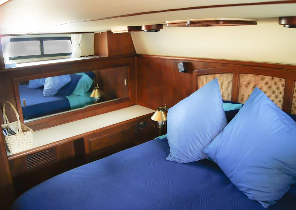 Master stateroom with a queen memory foam mattress and attached head (bath).