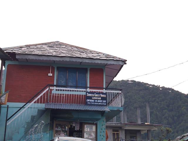 Old style wodden house in main market Bir