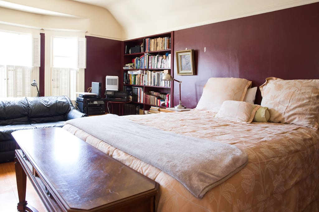 This is the front bedroom with a brand new bed and leather sofa comfortable enough to sleep on.