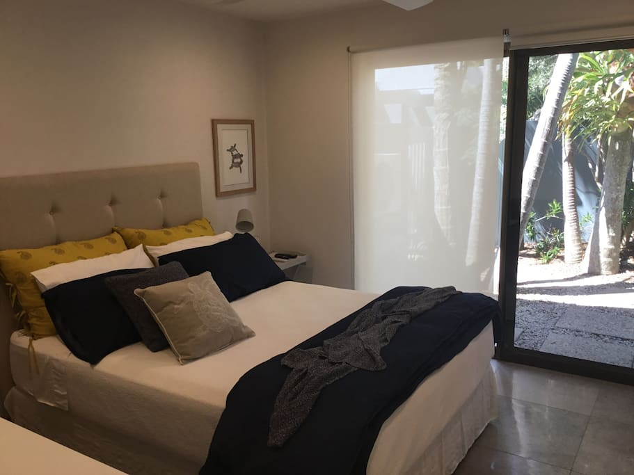 Your Private Oasis with a Queen Bed newly decorated. Sliding entrance door with security screen.