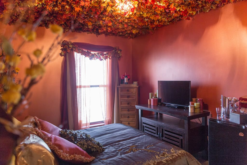 The guest bedroom The ceiling is covered in fall leaves like you are sleeping under a giant tree