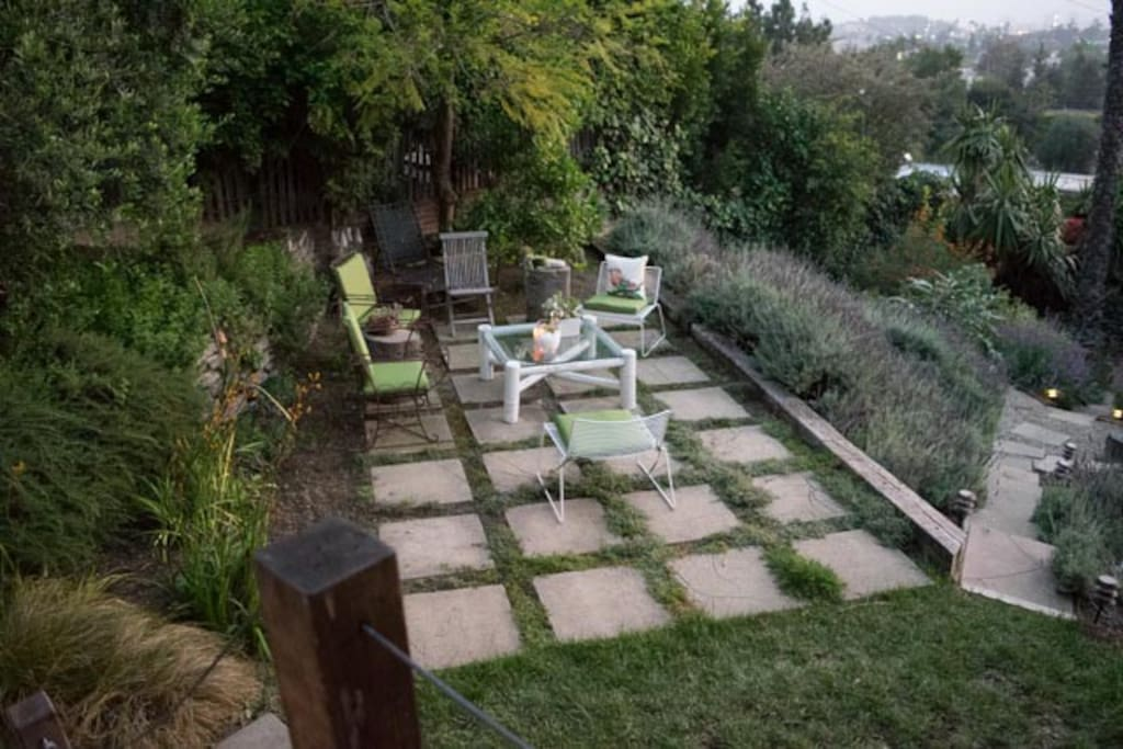 Beautiful patio and garden.  Path leads down to the vegetable beds