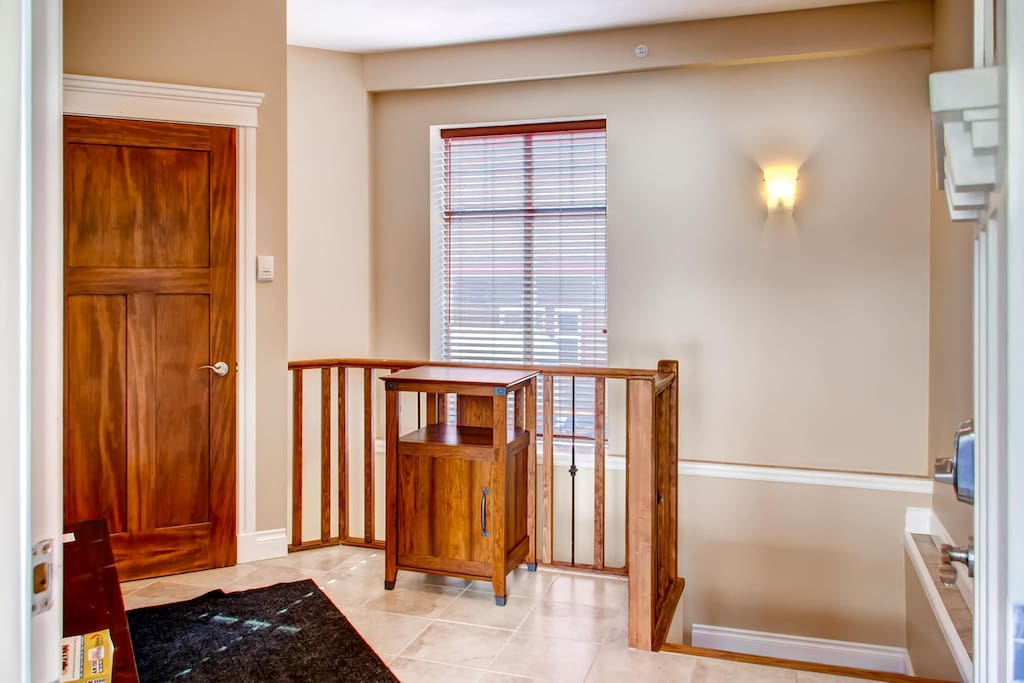 Entrance hallway, large built in closet, stairs down to bedrooms and living rooms