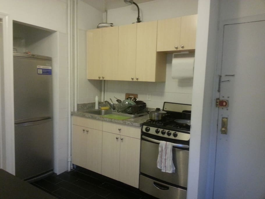 Kitchen: Copious storage space, featuring 1 year old stainless steel appliances.