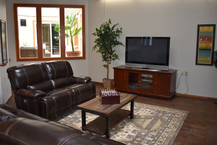 Family room features a 65 inch TV and games. Open floor plan facilitates socializing.