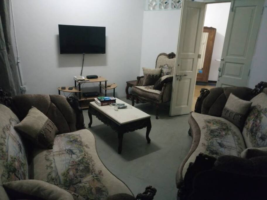living room area with game console,  TV cable and TV