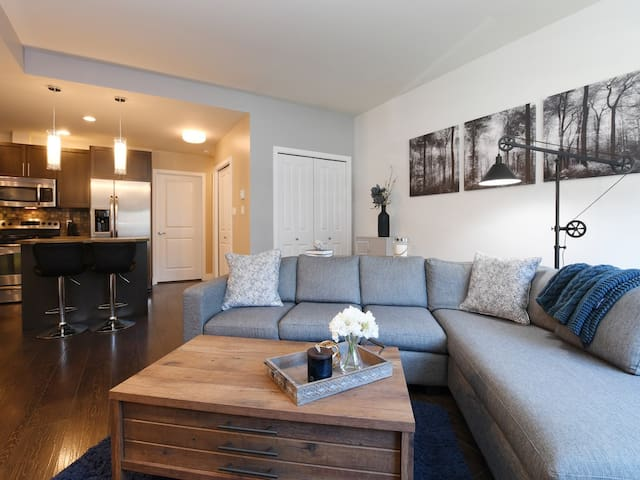 Open concept living space makes it easy to enjoy food, entertainment, and company all at the same time.