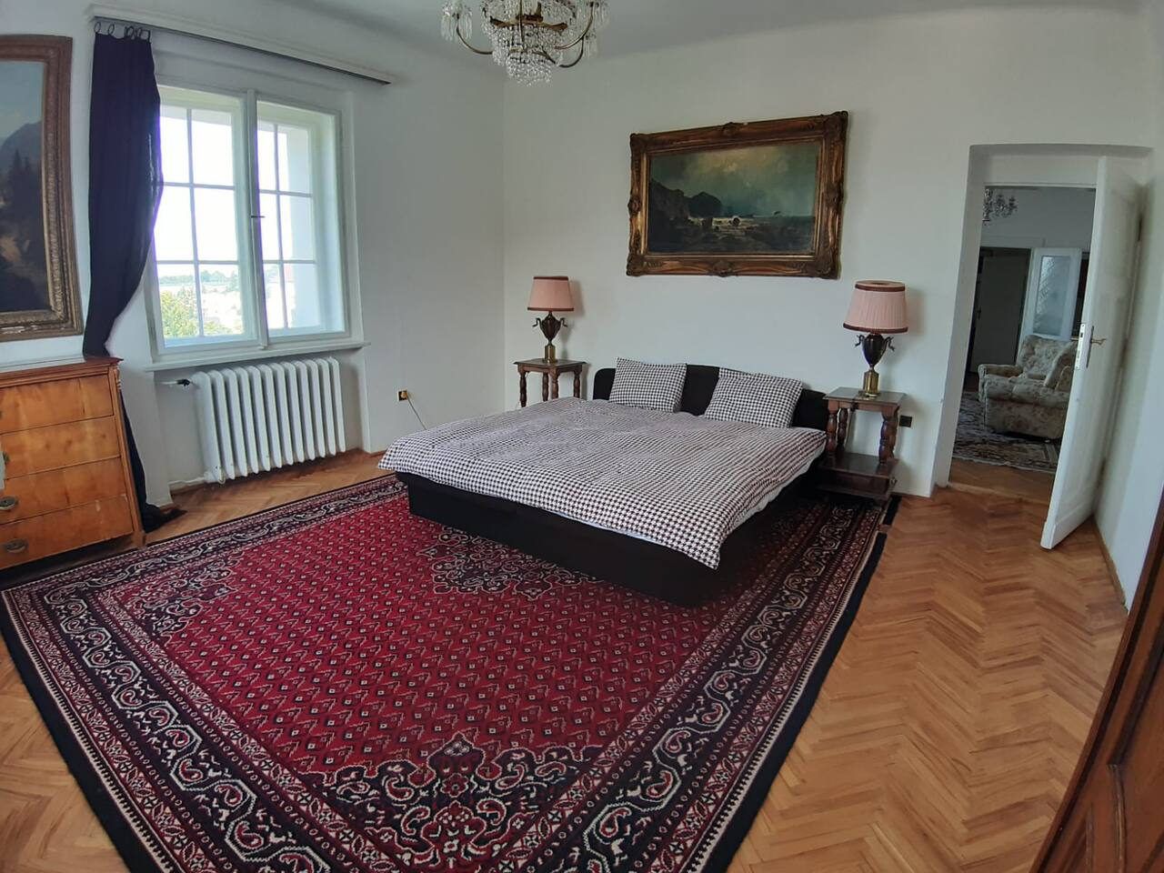 A beautiful and luxurious room on the top floor of a historic villa in a top neighborhood of Prague close to the river.  Full size kitchen, lovely view and a large terrace attached to a living room.