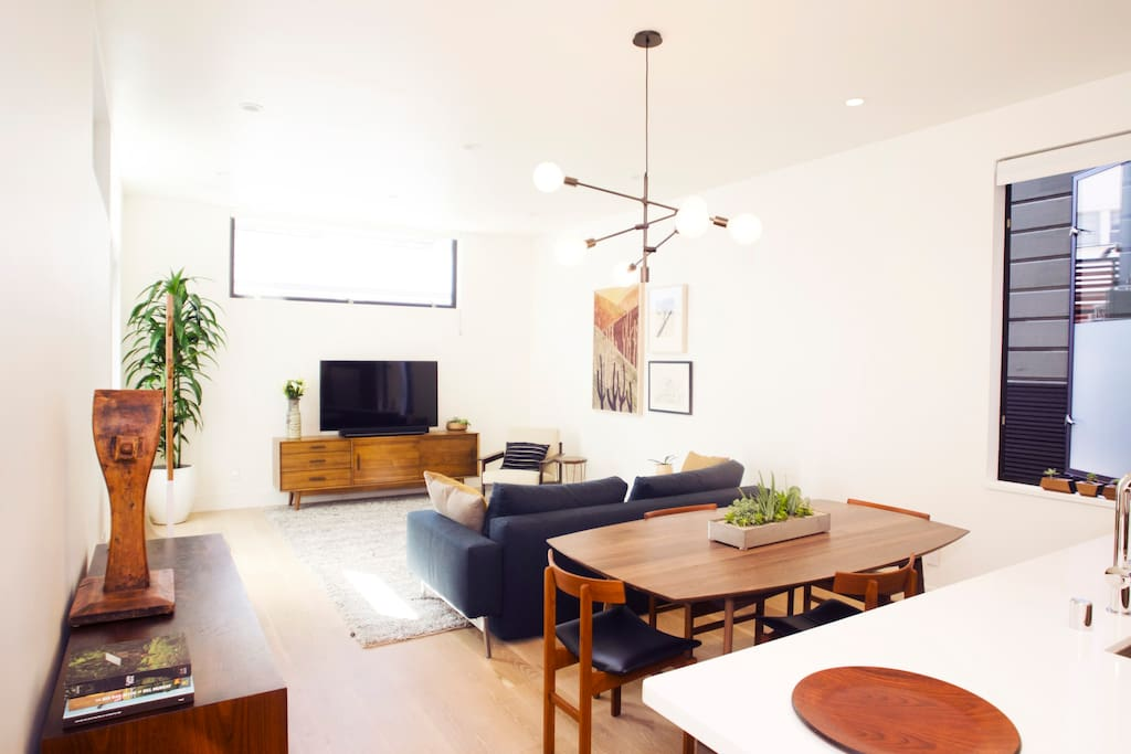 The space features a mix of vintage and new furniture pieces and accents.