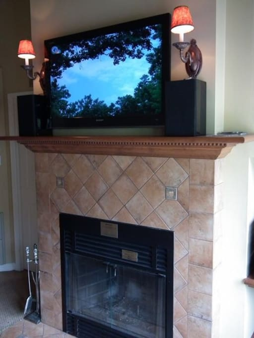 Wide screen HD TV and working fireplace.