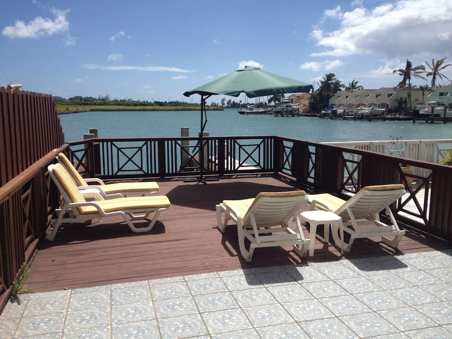 Large Deck area and dock, Retractable awning, BBQ and dining.