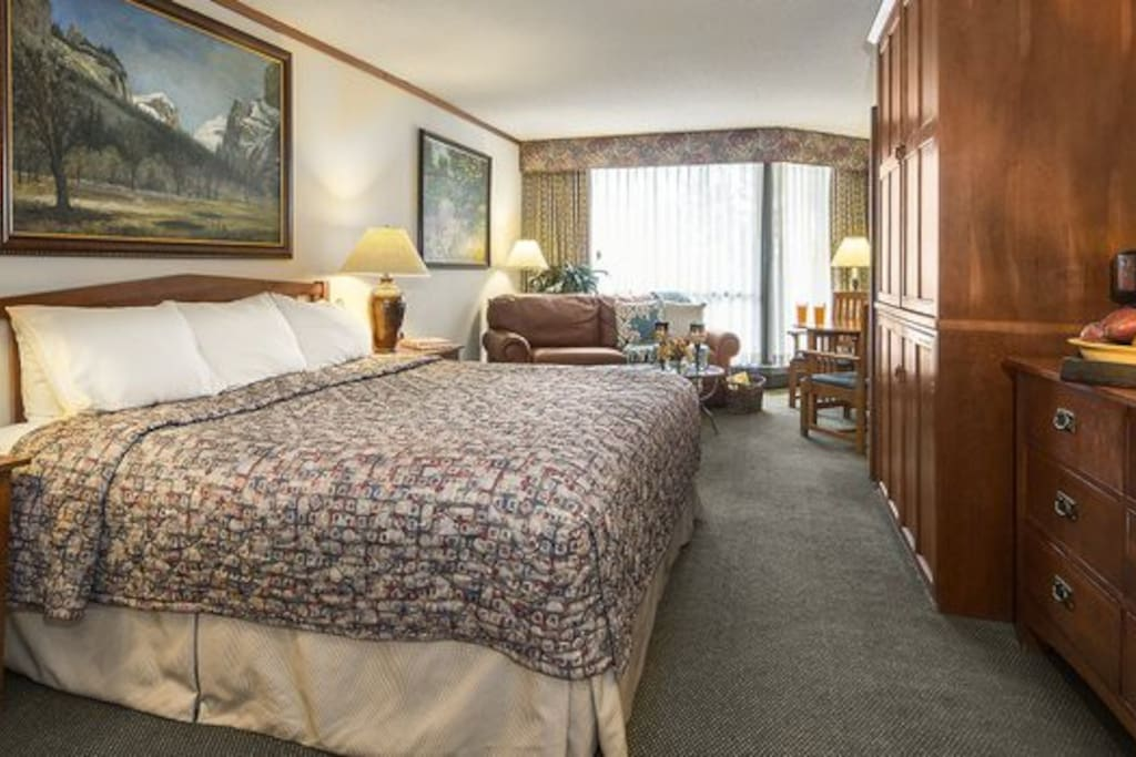 Bedroom #1: King-size bed, queen-size sofa bed, small refrigerator, wet bar with sink, microwave, full bath and an exterior balcony.