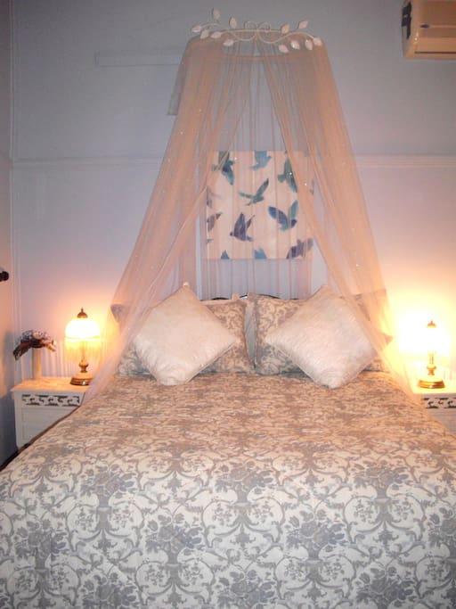 The 'Wedgwood' room has a double bed and a single day bed