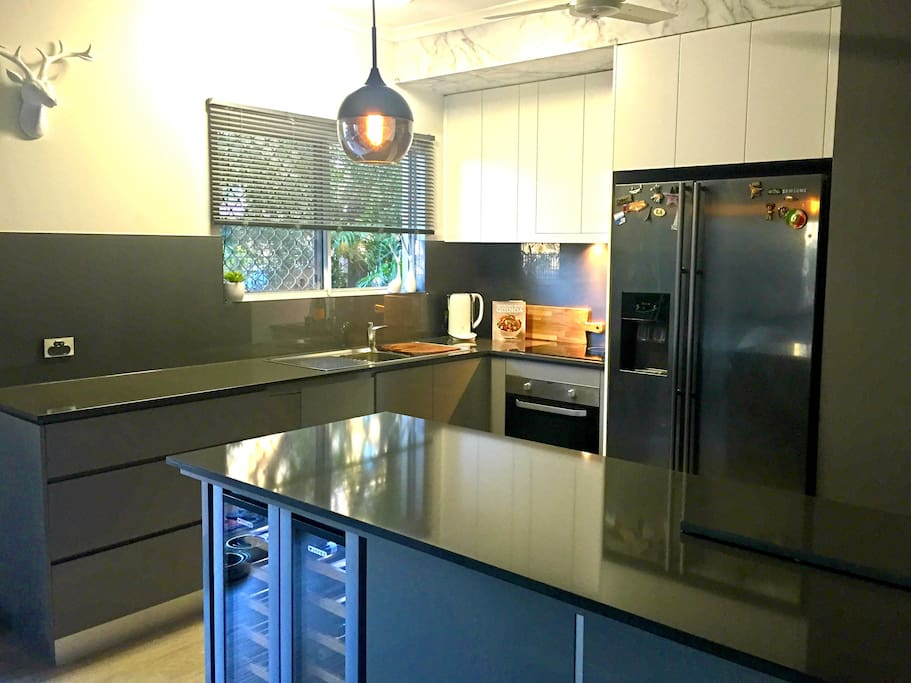 Quality designed kitchen with double door fridge/freezer & wine fridge