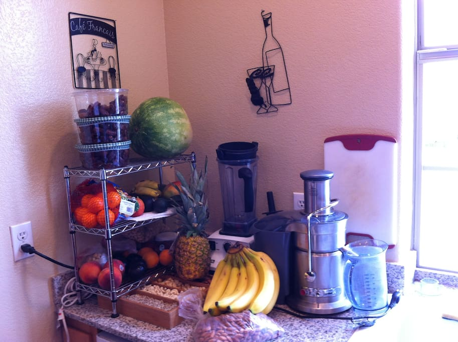 The kitchen, with tons of fruit and veggies, and a Vitamix and juicer...