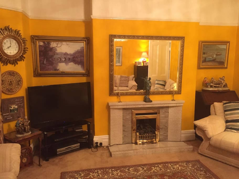 Large Comfortable Lounge with Flat Screen TV.