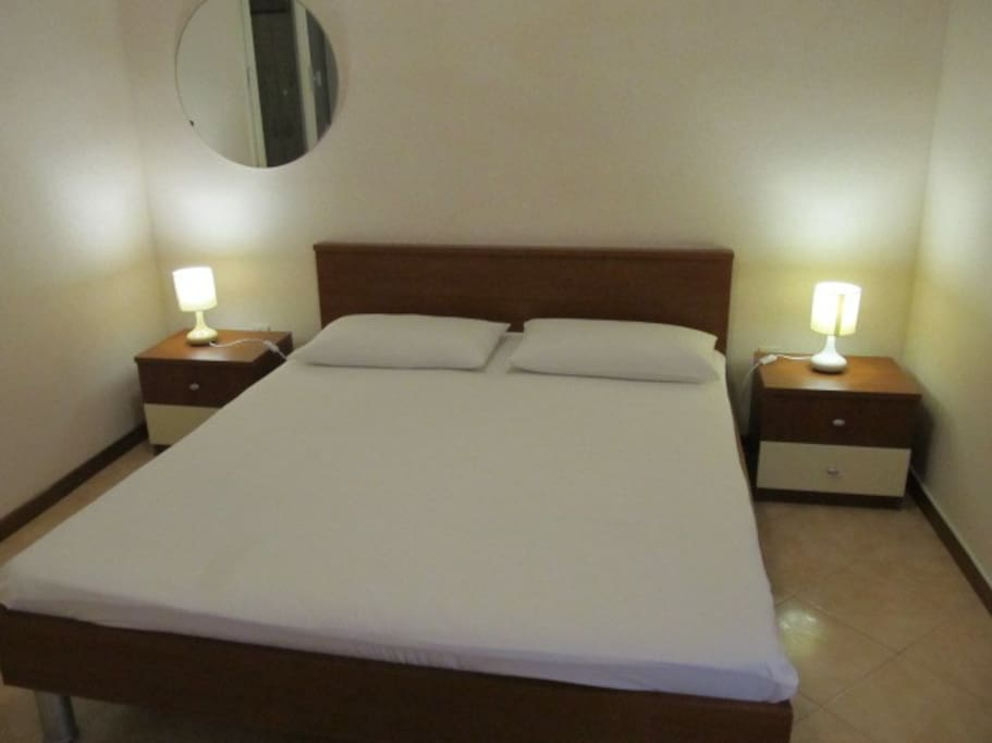 Comfortable bedroom with Air Conditioner available.
