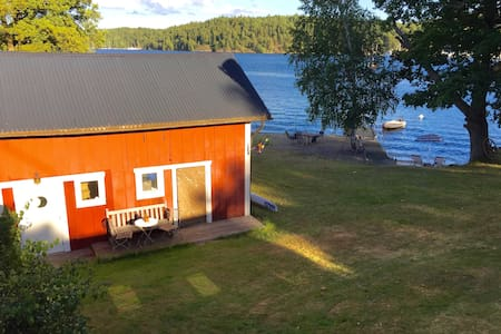 Cottage by the sea, it´s own sandy beach & boat.