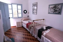 "Top left room (""Tinos room""), with 2 single beds and access to the veranda"