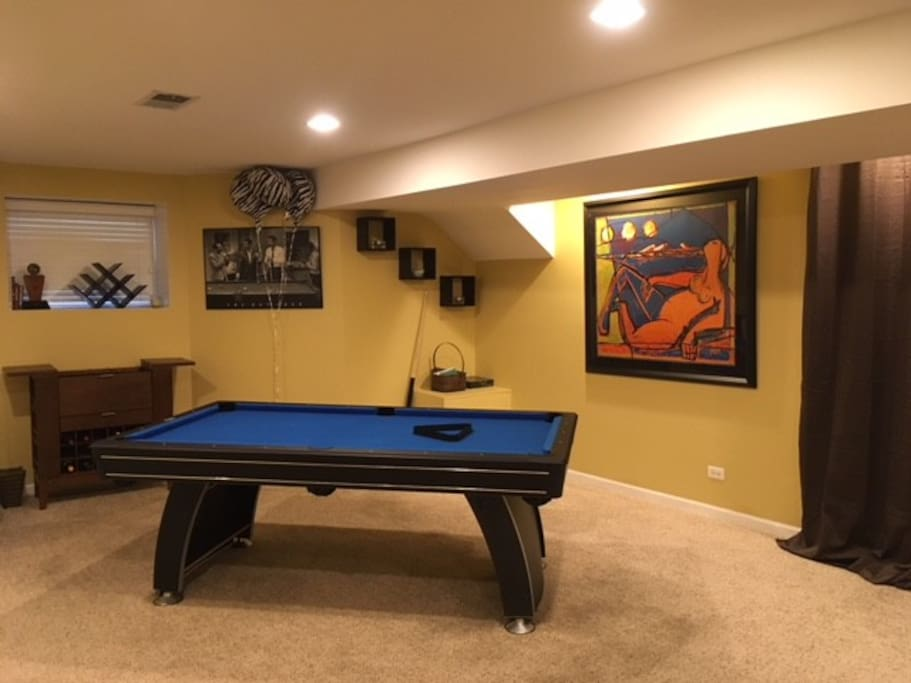Pool table and small bar area.