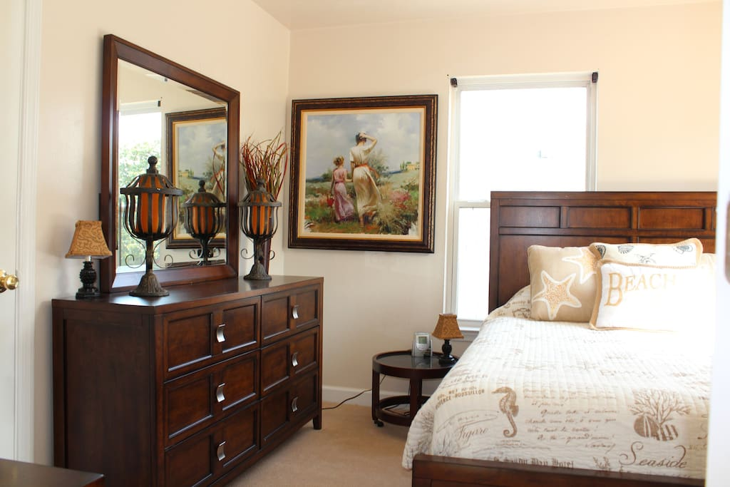 Queen size bed in upstairs room with great sun from the East.