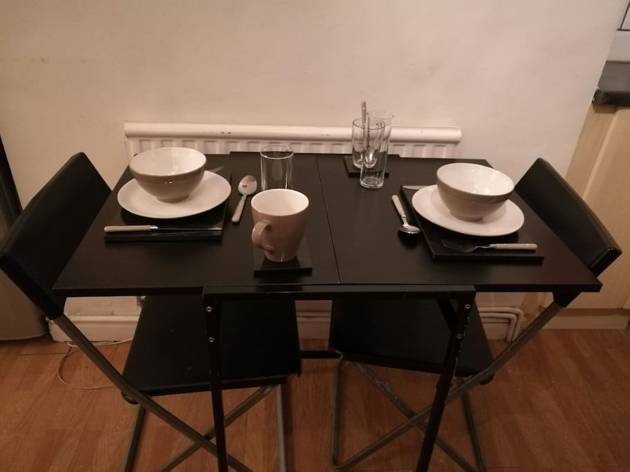 Dining table with crockery & cutlery supplied. Additional chairs available.