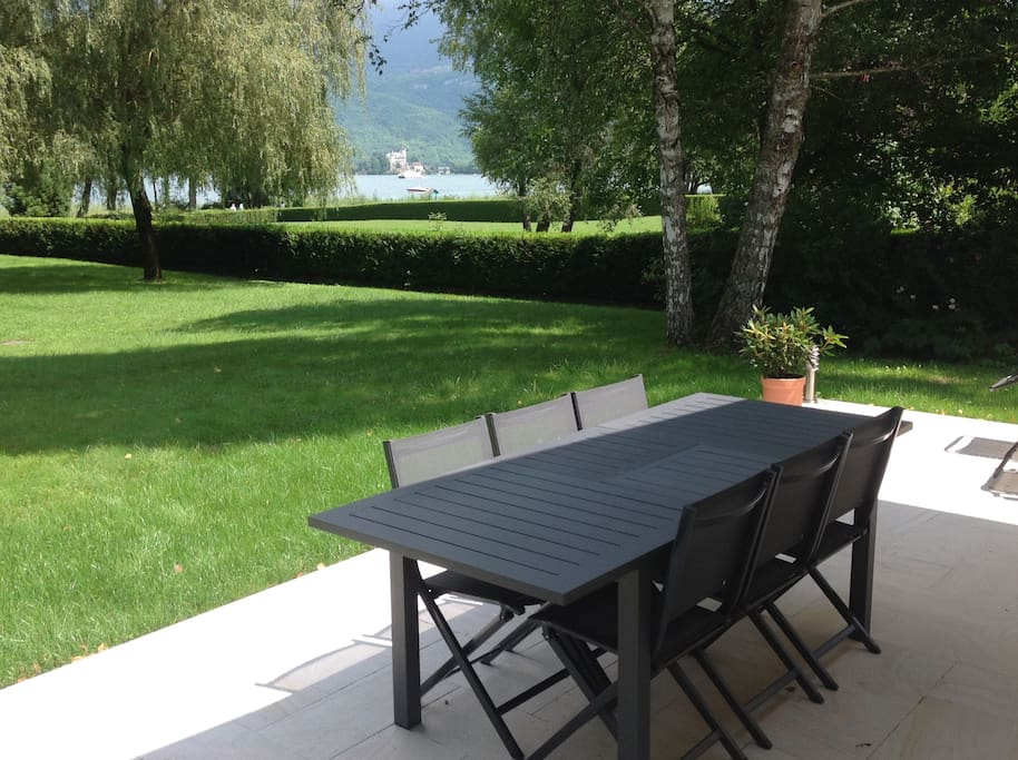 View from terrace across Lake Annecy to the mountains
