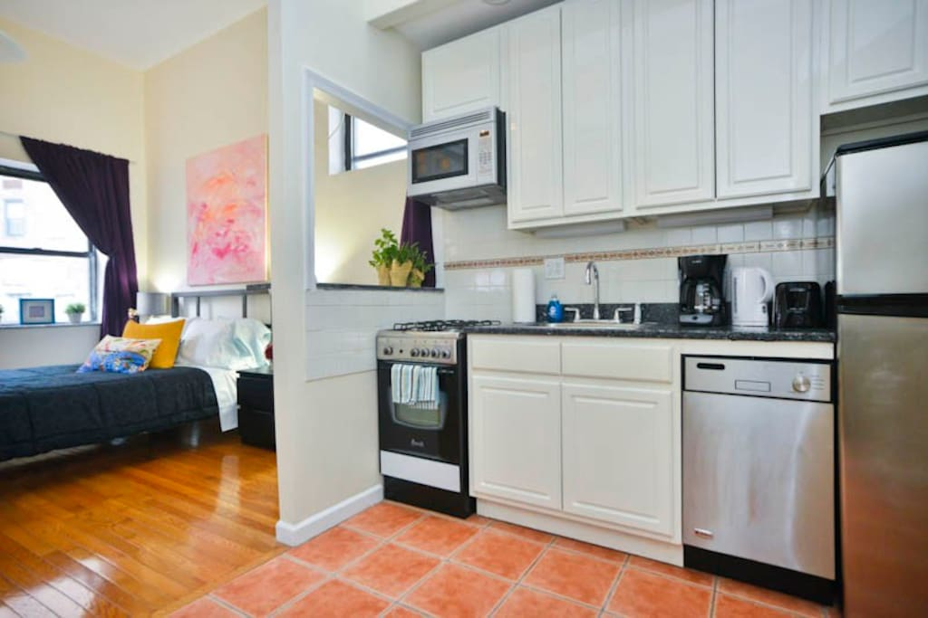 Open floor plan kitchen and dining area. White hardwood kitchen cabinets