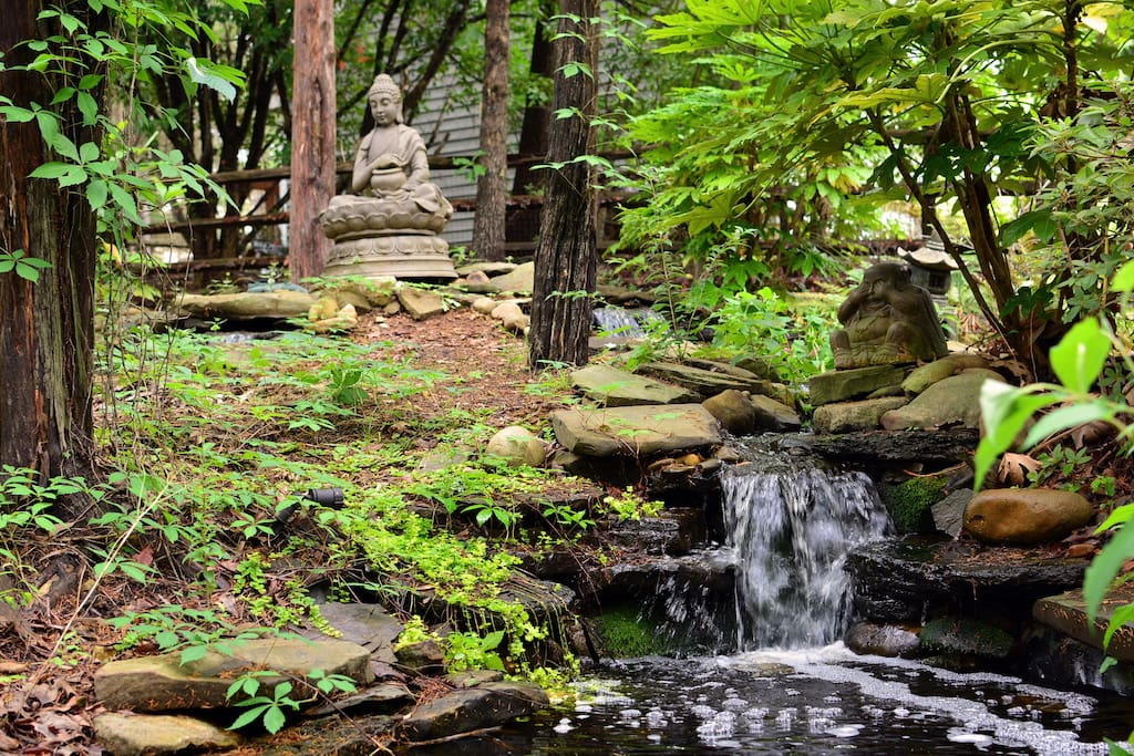 One of the TWO waterfalls and ponds in the tranquil back yard, perfect to enjoy while in the hot tub!