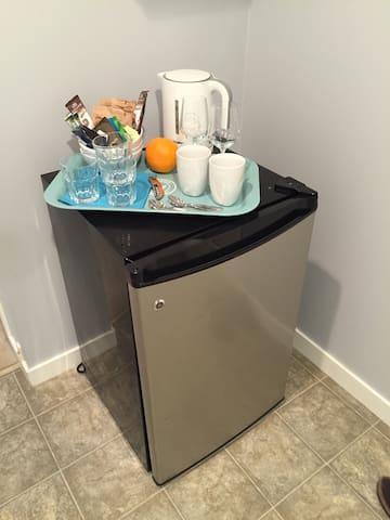 Mini fridge, kettle, bowls glasses and utensils for your use