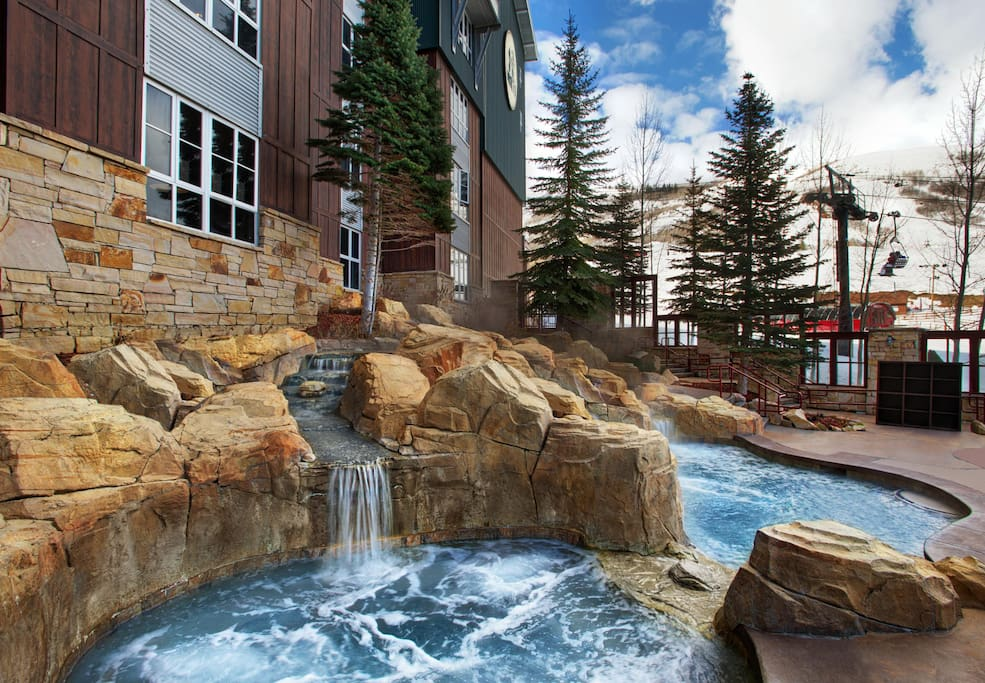 5 or six external hot tubs fed by hot waterfalls!