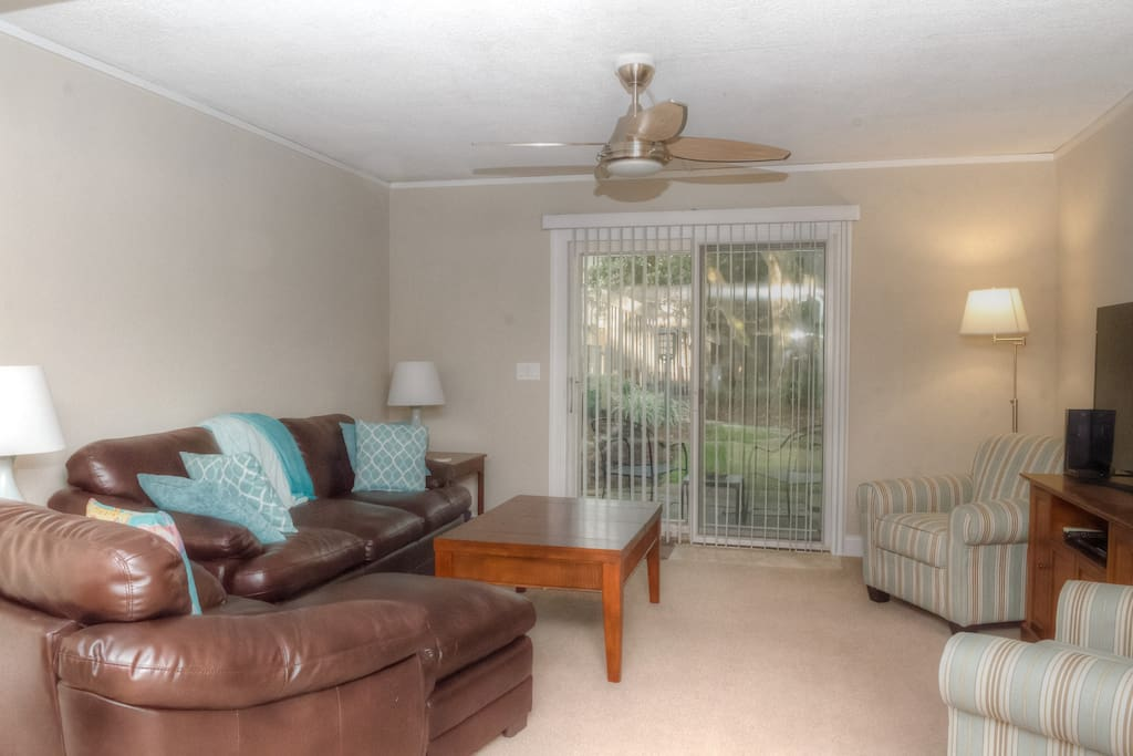 There is a patio with seating and a grill located off the living area thru the sliding doors.