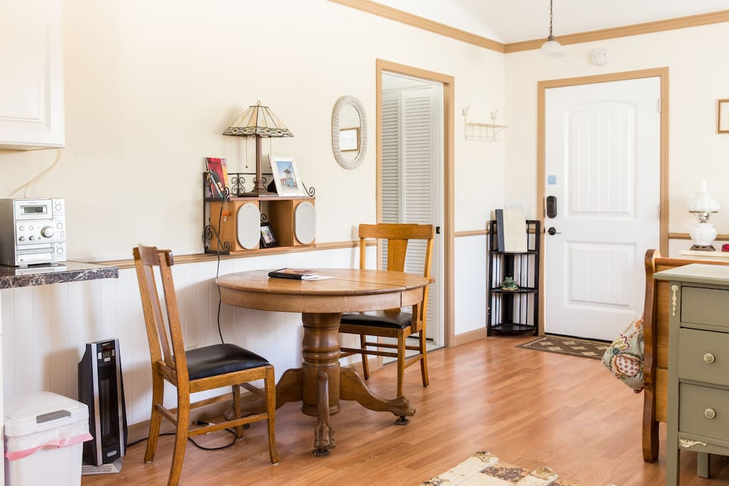Dining area next to kitchen with antique table