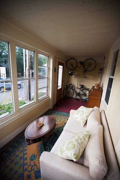 Enclosed front porch overlooking the most interesting street corner in Madison.