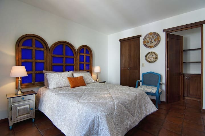 Master bedroom with King-size bed and private bath