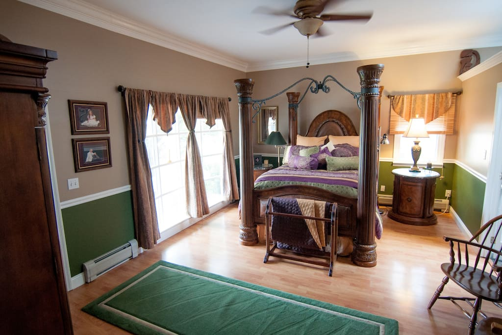 Master bedroom . . . one step down from dining room.  Queen Bed, 51 in flatscreen TV, and adjoining porch out front with swing and couch.