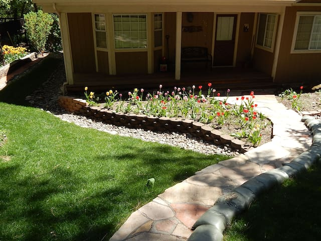 Grass and flowers greet you as you walk up to the front door.