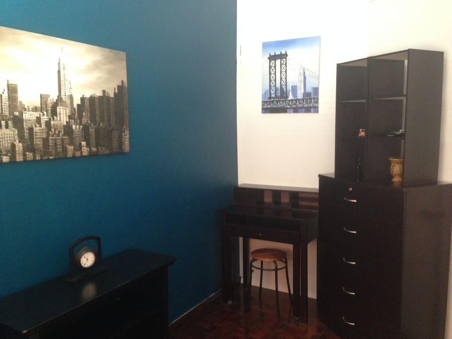 Room includes dresser and computer desk