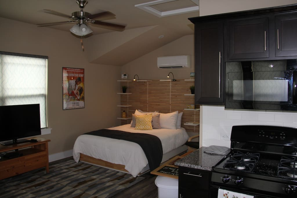 Queen size bed with reading lights on headboard.