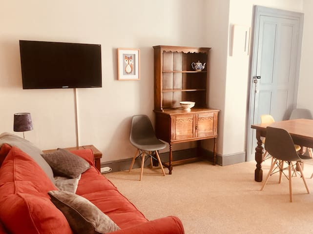 Lounge / Dining room.  2 x 3 seater sofas - one of these is a sofa bed.  2 x large foot stools that can also be used for seating.  Extendable dining table that can seat 8 people.  High Chair TV with freeview