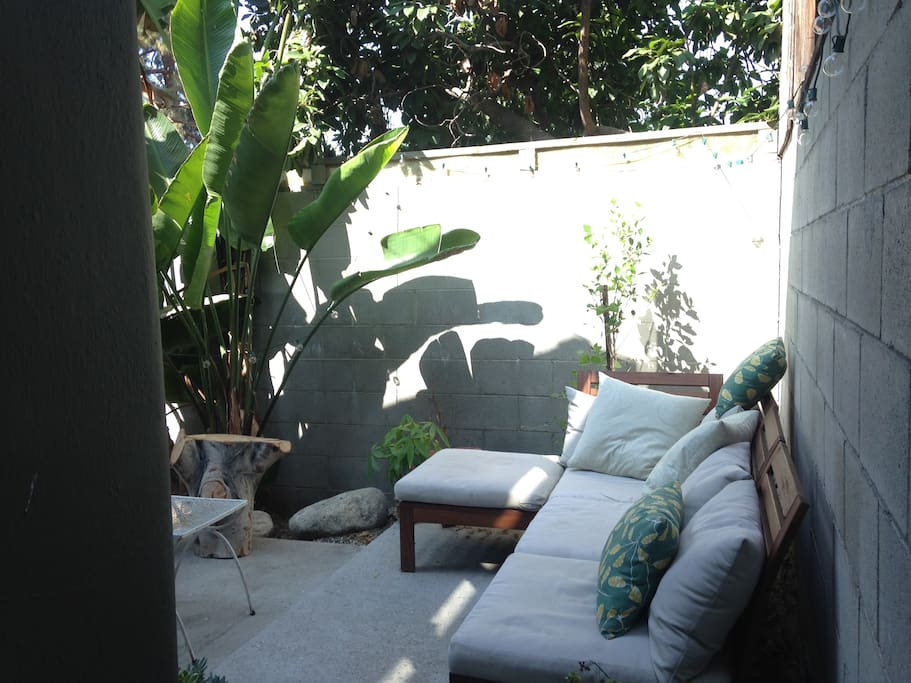 Patio with large couch.