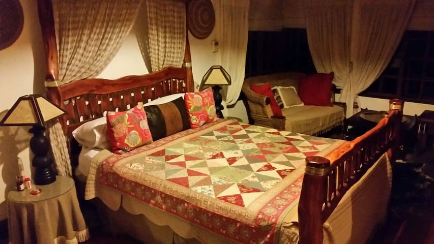 'Nguni ' room extra long queen double bed.