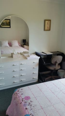 A desk and chair for the businessman. ground floor bedroom