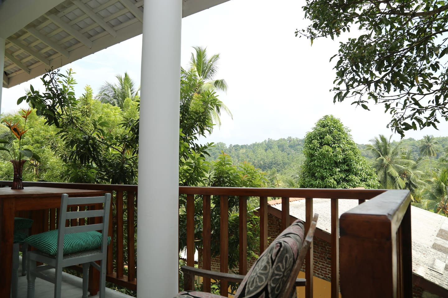 Apartment at Old Chilli House: The front entrance and balcony overlooking the lush green jungle.