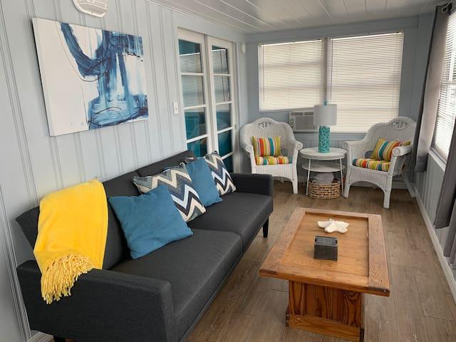 Enjoy the four seasons sun room with sleeper futon