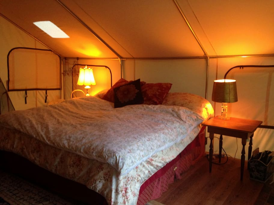 Beautiful handmade feather quilts, lights, rugs ... glamping!
