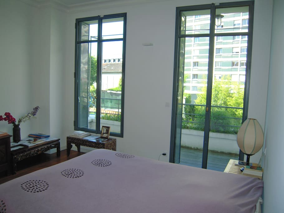 Double bedroom 1 with balcony Garden view