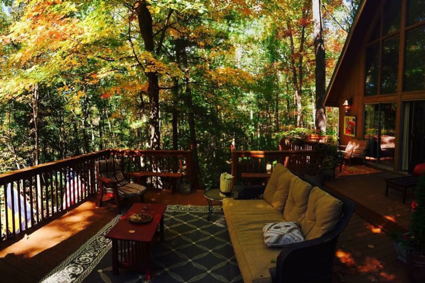 Beautiful deck with hot tub, two seating areas, full size couch, shade sail, umbrella & outdoor table.